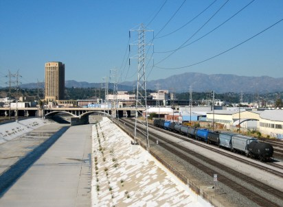 Looking north from 4th Street bridge at train yard, clear day