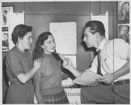"""Rehearsal--Robert Carson, director of the Tophatters, gives final instruction to his leading ladies before curtain goes up ... on the off-Broadway group's presentation of 'The Wallflower' at the Central Y. M. C. A., Hanson Place. At left is Joan Arnold. Beverly Zatt, center, plays the title role."" (1952)"