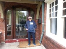 My dad in front of his old house.