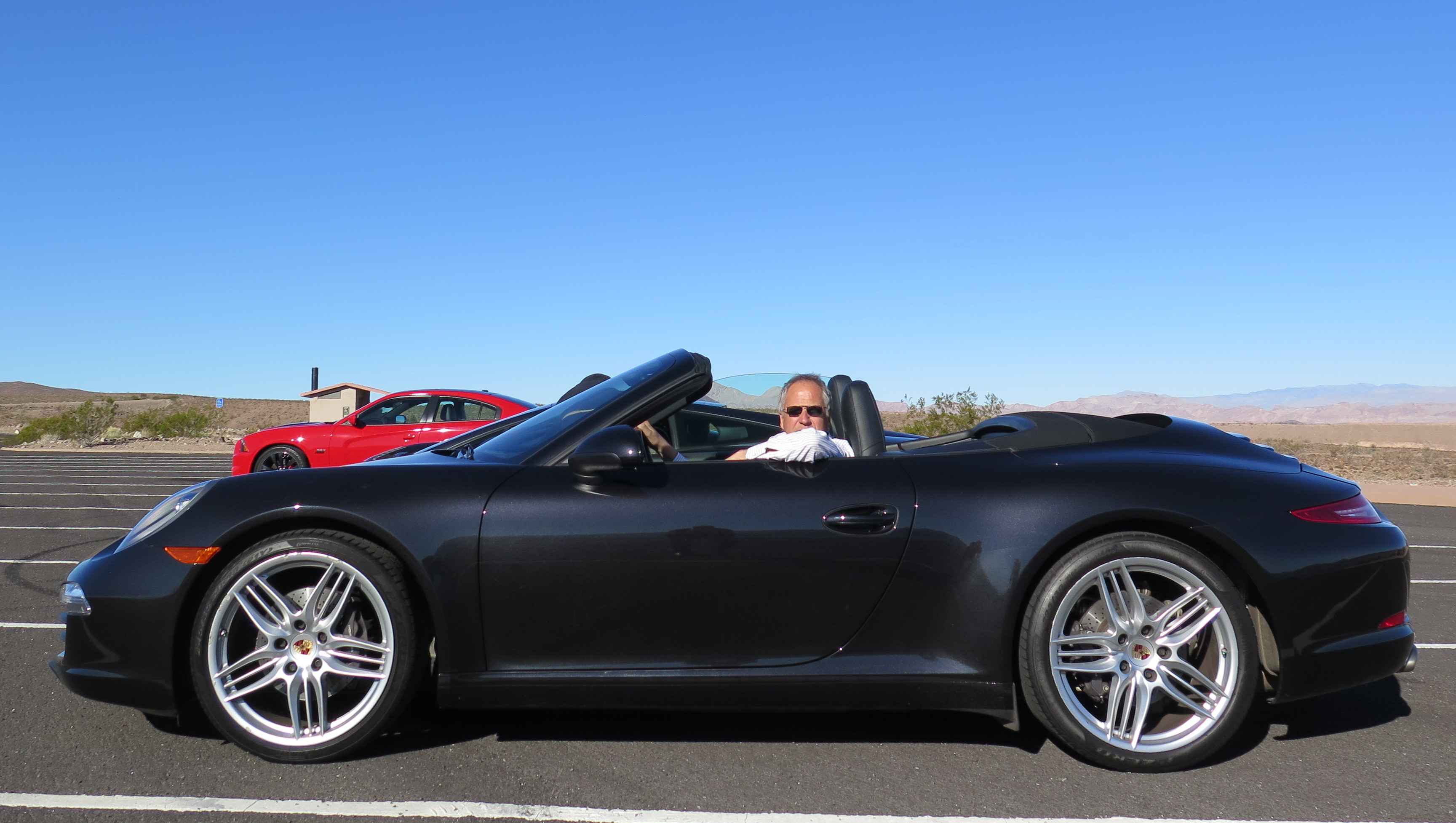 Yours truly in a sleek Porsche Carrera; my new dream car.