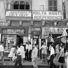 A_view_of_shops_with_anti-British_and_pro-Independence_signs,_possibly_on_Kings_Street,_Valetta,_Malta_(5074435957)