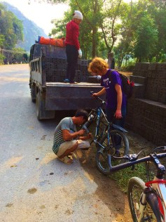 Nick getting his bike fixed by a local bricklayer