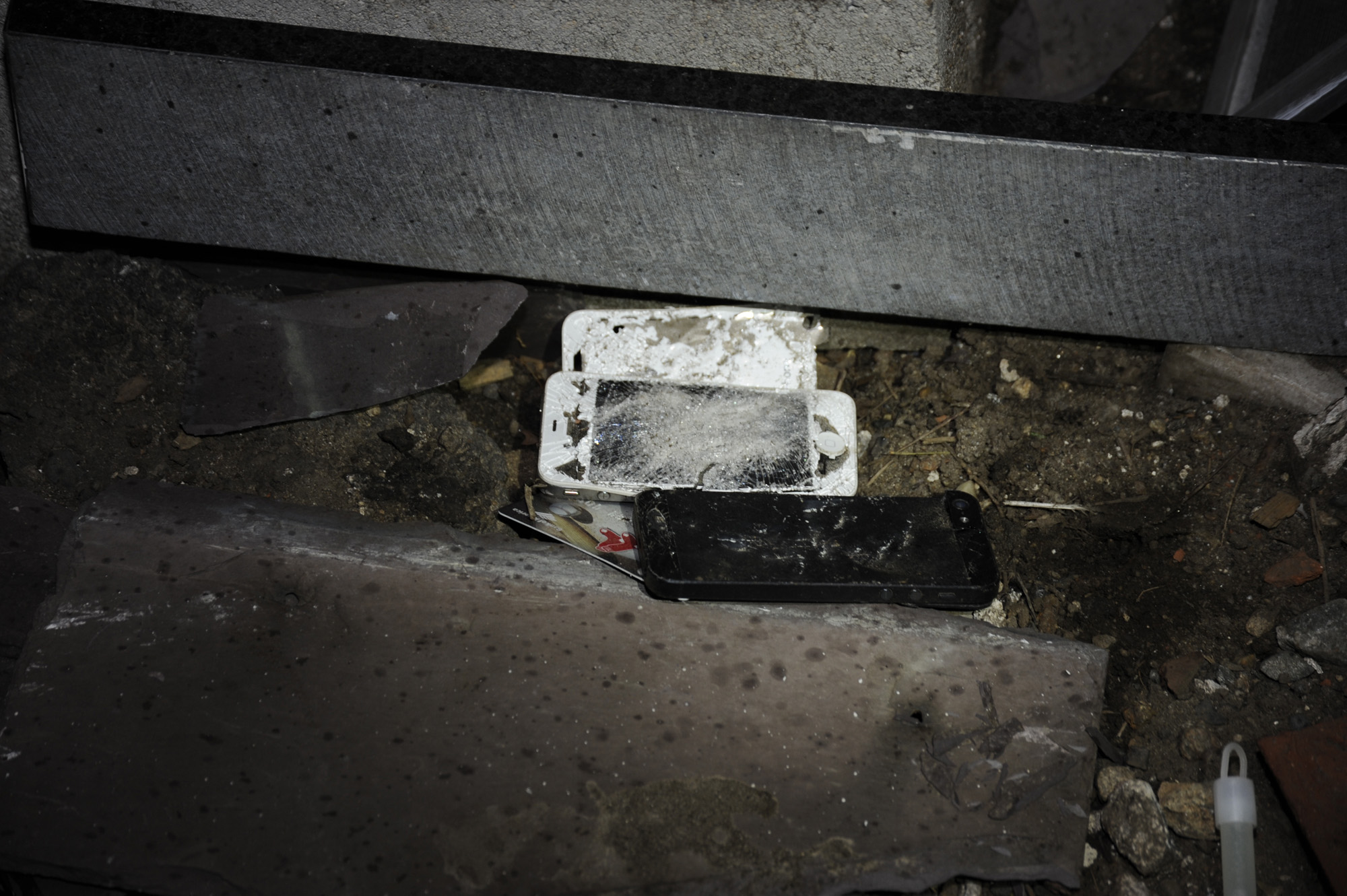 Exh 810 – 06 Smashed phones & ATM card (in situ)