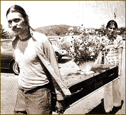 Sidney Marshall and Jane Egbert haul coffin to hearing.