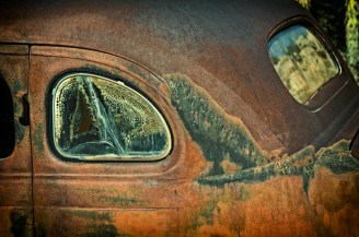 Rust-colored antique car inside Desert Ranch