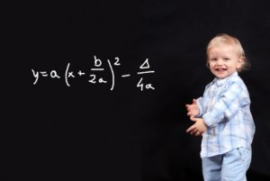 Little boy writing a complicated mathematical formula