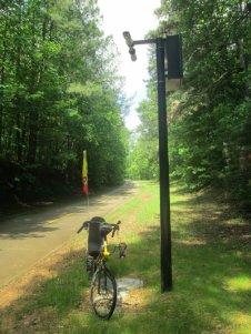 Jim-Schmid's-Bacchetta-Giro-recumbent-next-to-security-camera-on-Silver-Comet-Trail-GA-2015-5-11-to-14