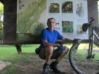 Jim-Schmid-with-mtn-bike-at-end-of-trail-Greenbrier-River-Trail-WV-06_21-to-24-2015