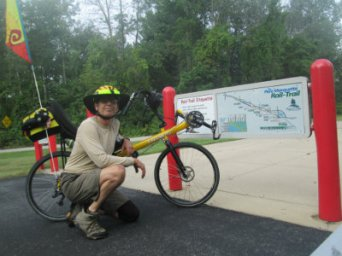 Jim-Schmid-with-Bacchetta-Giro-Recumbent-next-to-sign-Pere-Marquette-MI-2015_09-06