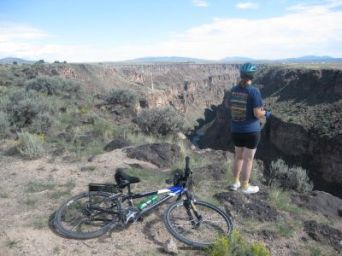 Sandra-Schmid-overlooking-canyon-on-West-Rim-Trail-Taos-NM-2010