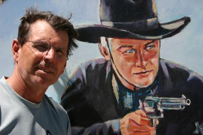 Jim-Schmid-in-front-of-Hopalong-Cassidy-mural-CA-25th-wedding-anniversary-trip-2010