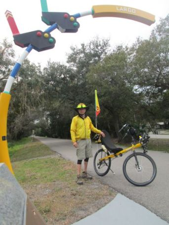 Jim-Schmid-with-Bacchetta-Giro-recumbent-at-Largo-sign-on-Pinellas-Rail-Trail-FL-1-25-2016