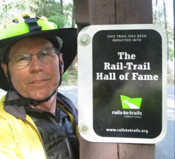 Jim-Schmid-next-to-Hall-of-Fame-sign-Trail-of-the-Coeur-d'Alenes-ID-5-14-2016
