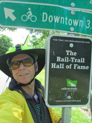 Jim-Schmid-next-to-Hall-of-Fame-sign-on-Burke-Gilman-Rail-Trail-Seattle-WA-4-26-2016