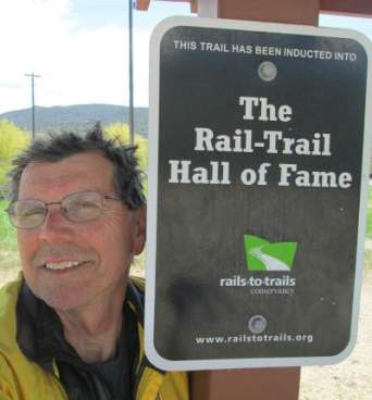Jim-Schmid-next-to-Rail-Trail-Hall-of-Fame-sign-on-Union-Pacific-Rail-Trail-Park-City-to-Echo-UT-5-1-2016