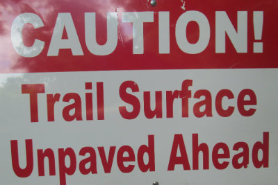 Caution-trail-surface-unpaved-ahead-sign-Tanglefoot-Trail-MS-2015-06-13