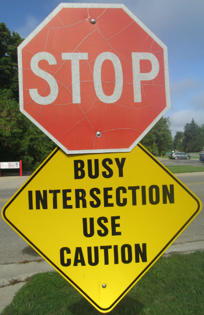 Stop-with-busy-intersection-use-caution-sign-Pere-Marquette-MI-2015-09-06