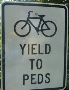 Bicycle_symbol_yield_to_peds_sign_Greensboro_NC_RT_System_2015_07_06