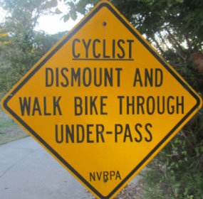 Cyclist-dismount-and-walk-bike-through-under-pass-sign-W&OD-Rail-Trail-VA-2015-10-6&7