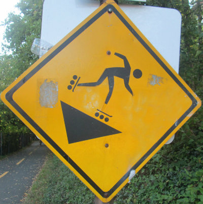 Caution-skating-downhill-symbol-sign-W&OD-Rail-Trail-VA-2015-10-6&7
