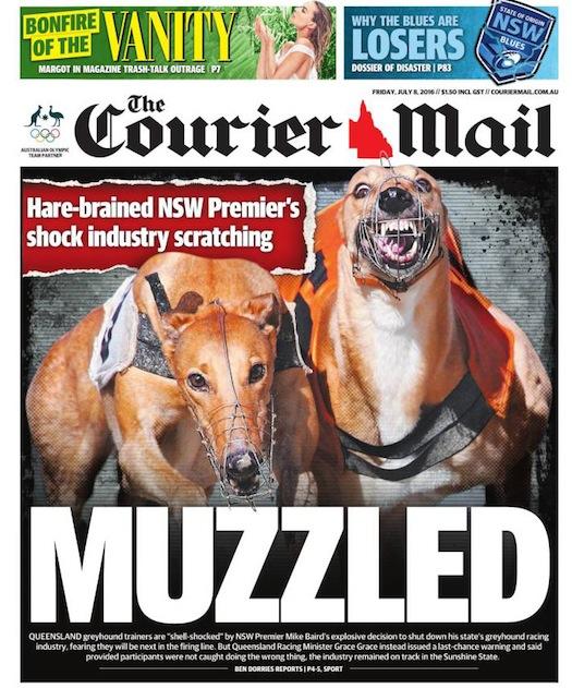 """นสพ. the Courier Mail พาดหัว """"สวมตะกร้อครอบปาก"""" (หมายถึงการแบนการวิ่งแข่งสุนัข) : """"นายกฯน.ซ.ว.ผู้ขาดสติทำช็อคด้วยการถอนการแข่งขัน (สุนัขเกรย์ฮาวด์) ออกไป"""""""