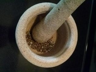 1 cardamom seeds in mortar and pestle1