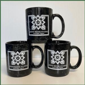 Photo of three Jinny Beyer Studio mugs with square logo and city Great Falls, Virginia