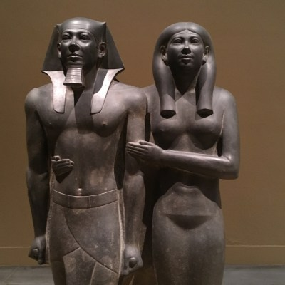 #18. King Menkaura and queen. Old Kingdom, Fourth Dynasty. c. 2490–2472 BCE. Greywacke.