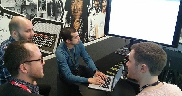 3 Amigos gather around a BBC iPlayer screen