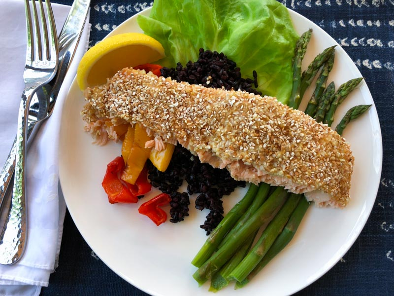 kasha crusted salmon with black rice, roasted asparagus and peppers