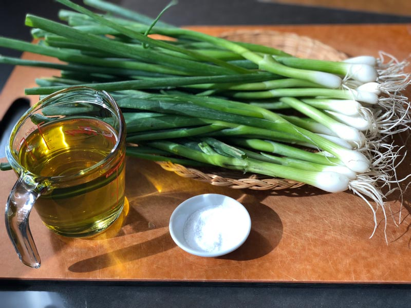 Slow Cooker Caramelized Scallion Sauce ingredients on a cutting board