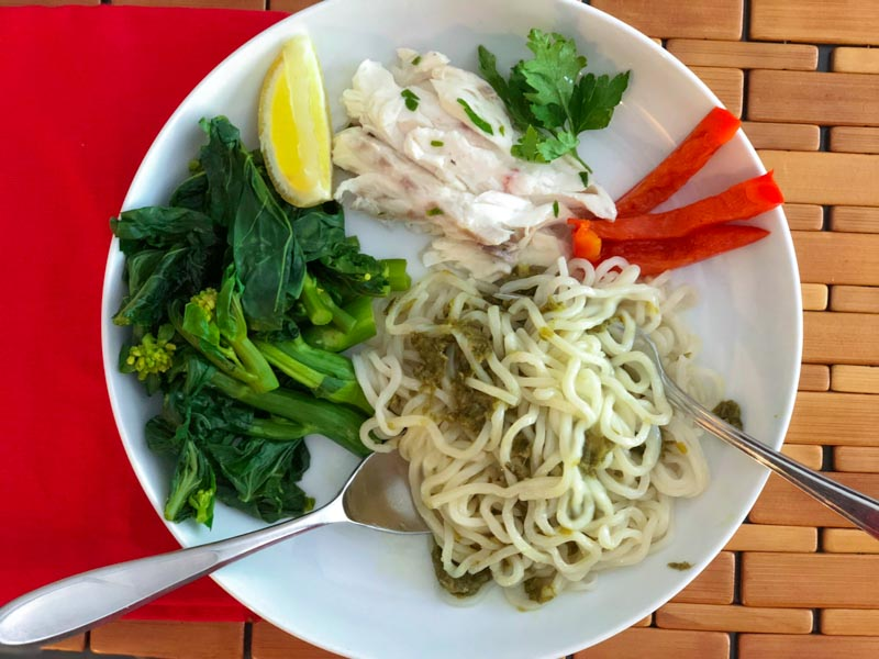 Slow Cooker Caramelized Scallion Sauce on noodles with a fish dinner