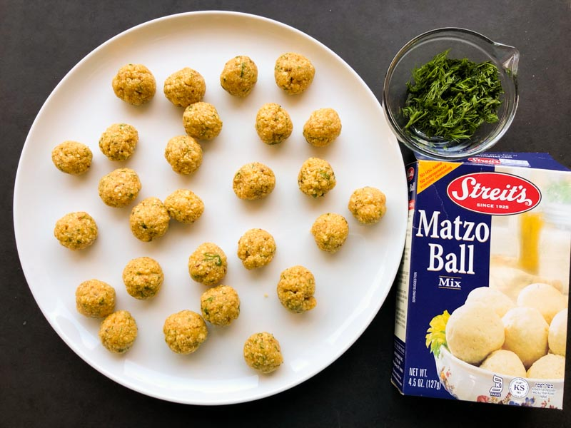 Mini Dill Matzo Balls, just formed, on a plate