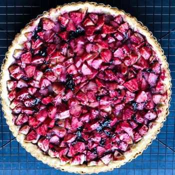 Blackcurrant Apple Pear Tart out of the oven, on a cooling rack