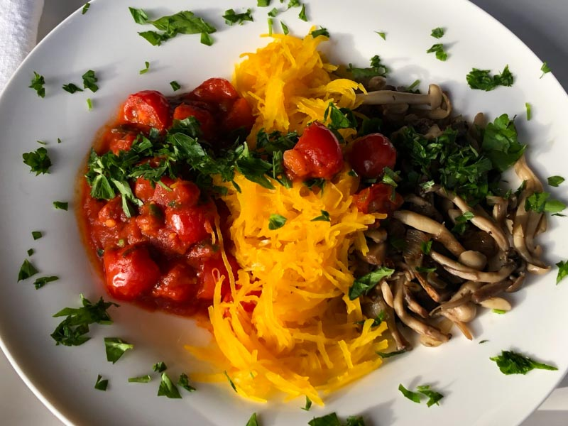 Mushroom Marinara Orangetti Squash plated with parsley garnish