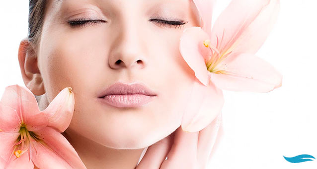 Everything You Always Wanted To Know About Botox | Girl with flowers on her face | Jiva Spa Toronto anti aging facials beauty spa salon skin rejuvenation medispa