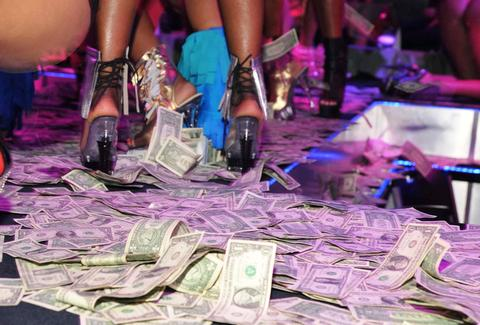 Strippers dollars on the ground in the club and stripper shoes