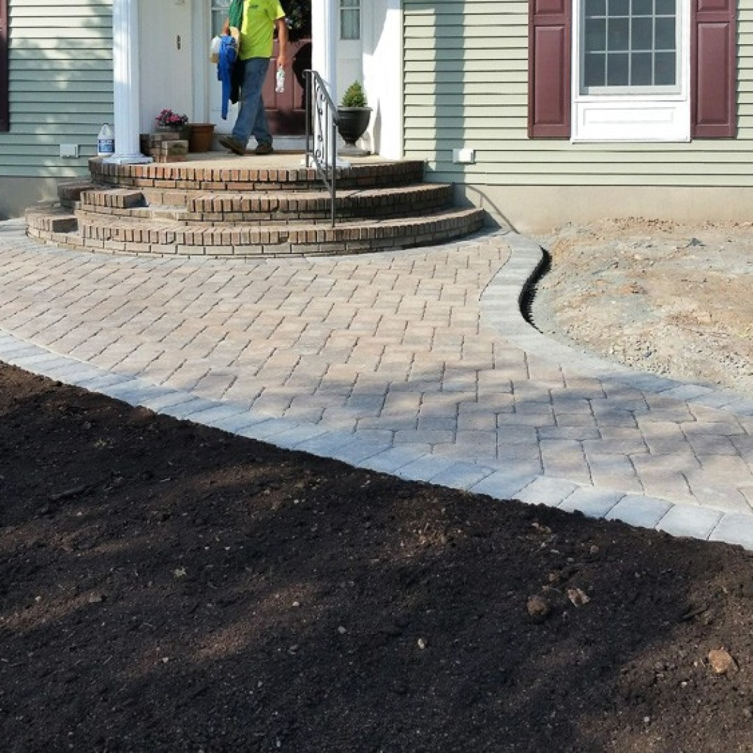 Unique Walkway blends into small Patio and front steps