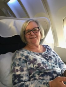 Kathleen in her REAL business class seat on our first flight