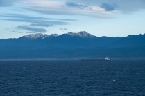 We sail through the Straits of Juan de Fuca at the end of the day.