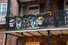 Masks and purple, gold and green are everywhere.