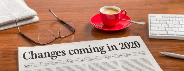 A newspaper on a wooden desk - Changes coming in 2020