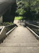 As soon as I cross the bridge, I head down these stairs to walk the dirt path on the far side of the river.