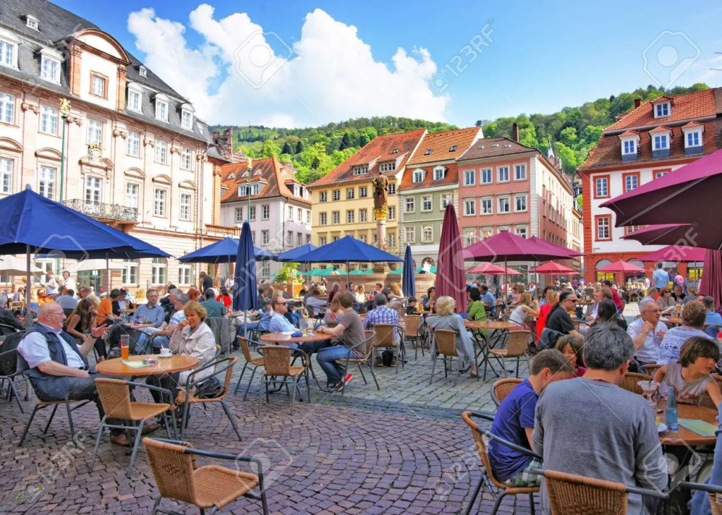 Marketplace crowded with tourists and Town Hall in Heidelberg