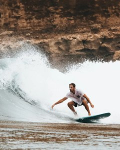 man surfing on ocean waves