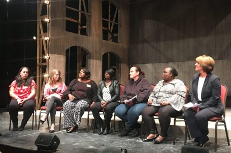 panel of seven women from grace house seated onstage