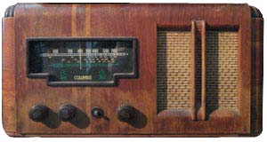 The same Columbus valve radio we had when I was a kid. I spent many happy hours twiddling its knobs, discovering the big world out there on the short-wave bands. Foreign languages! Morse code! Most stations faded in and out, but reception was usually pretty good for Voice of America and Voice of the Andes. Unfortunately the latter station only peddled religion. I used to believe that if Dad would put up a really big aerial, the world would truly be my oyster. Actually the aerial was pretty long, but I always thought he was short-changing us.