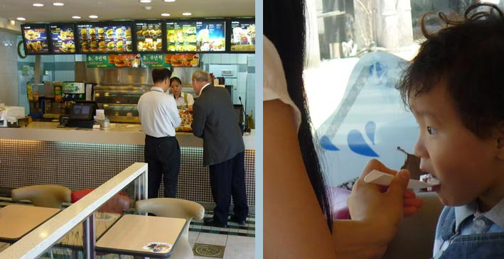Hamburgers to go at Lotteria, Korea's equivalent of McDonalds. Right: young woman feeding her child in the Lotteria restaurant.
