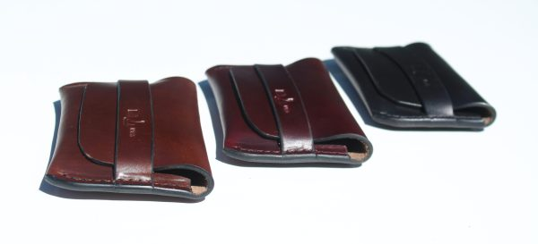 Tuck pocket leather wallets