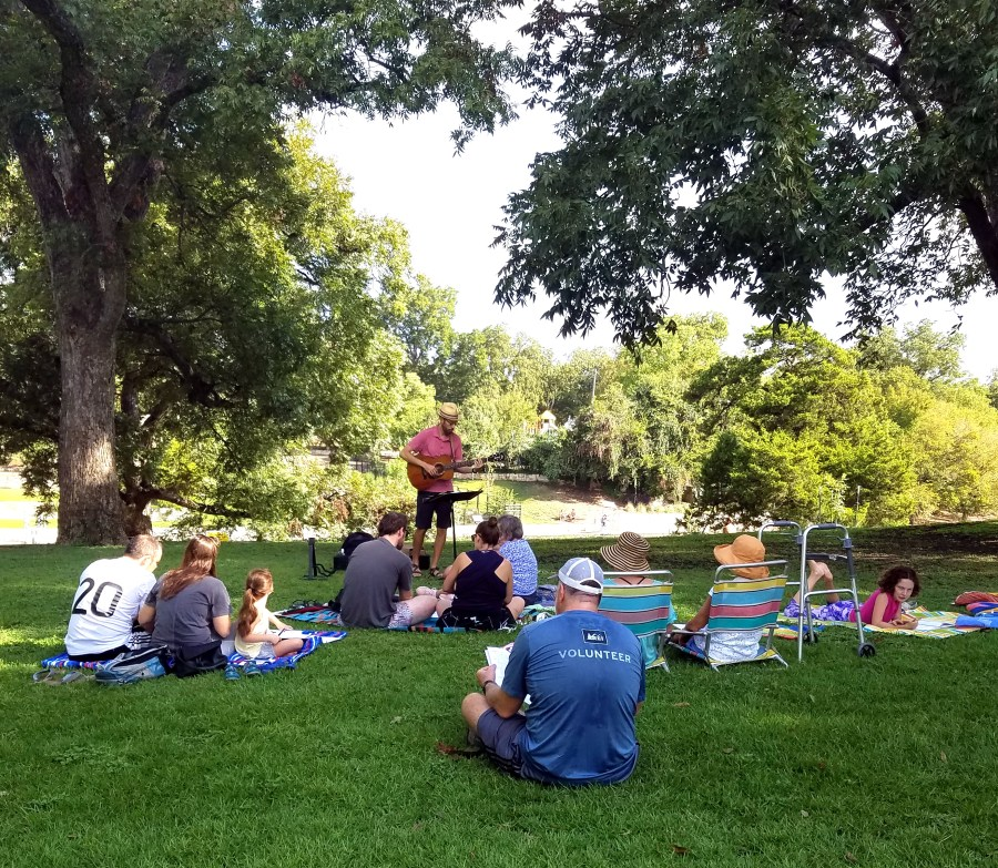 J leading singalong group w Barton Springs behind